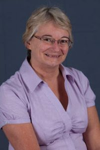 Image of Jenny Chesters in a purple shirt smiling and looking at the camera