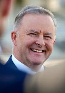 Image of Anthony Albanese Smiling with a blurry background
